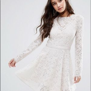 Long sleeve open back white lace dress